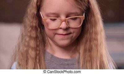 Cute little girl in glasses smiling - Half length of...