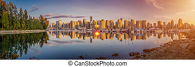 Beautiful Vancouver skyline and harbor with idyllic sunset glow, Canada