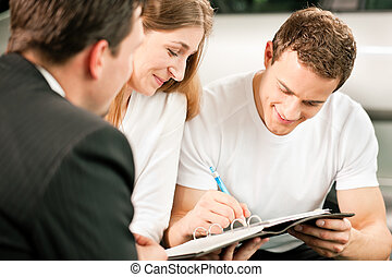Couple signing sales contract - Sales situation in a car...