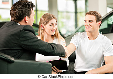 Handshake to buy that car - Sales situation in a car...