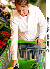 Man in supermarket - Man in a supermarket at the vegetable...