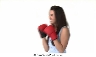 Athletic asian woman with boxing gloves against white...