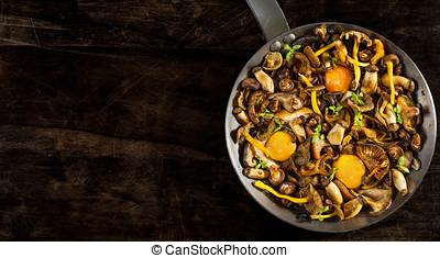 Frying pan steel with mushrooms and soft egg yolks. - Frying...