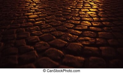 Ancient urban pavement close up 4K steadicam night shot -...