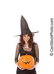 Teenaged girl in Halloween costume with pumpkin - Portrait...