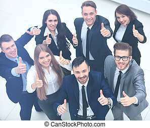 Top view of executives smiling and pointing