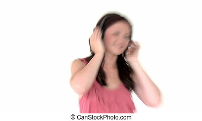Radiant young woman listen to music wearing headphones...