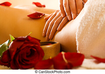 Back Massage - Woman enjoying a massage in a spa setting