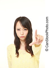 young Japanese woman scolding - studio shot of young...