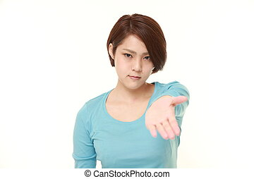 angry young Japanese woman requests something - studio shot...