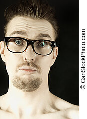 man in glasses with funny face clo