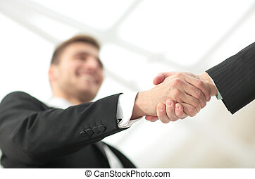 Businessman by handshake invites to cooperation. - Portrait...