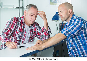 construction manager resolving a problem with colleague