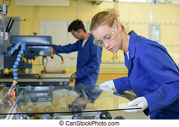Young people in glass factory
