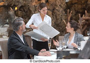 couple in restaurant choosing menu