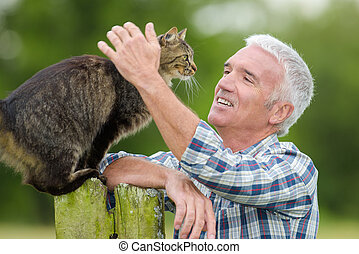 Man caressing cat