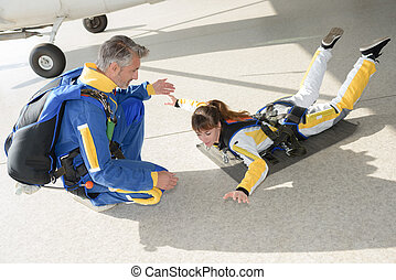 Woman practicing skydiving posture
