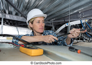 female electrician with cables