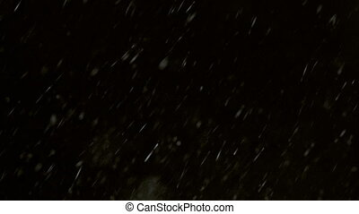 Winter Snowfall Black Background - Isolated snow falling on...