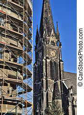 building in Berlin Kreuzberg with scaffolding and church