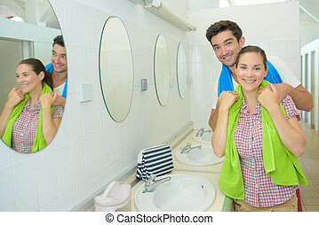 Portrait of couple in communal washroom