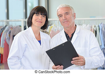 Portrait of couple with clipboard