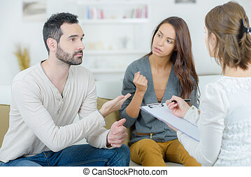 stressed young couple quarrel at the psychologist