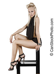 sitting woman in black - beautiful young sensul blond woman...