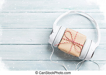 Christmas music gift concept. Headphones and gift box on...