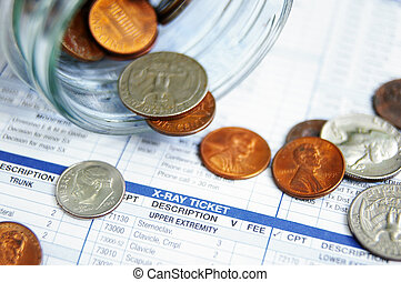 closeup of coin jar money on a medical bill