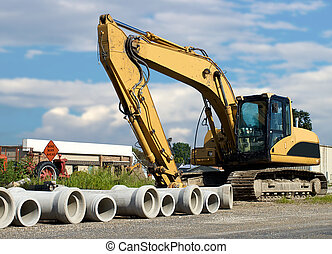 cement pipes with backhoe  - cement pipes with backhoe