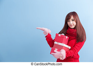 beauty woman take gift and show something in christmas...