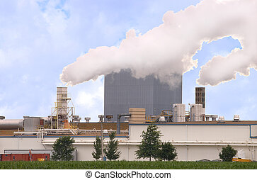 Gypsum factory with smoke stacks and blue sky