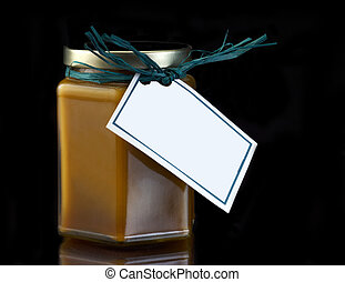 Candle with gift tag on black