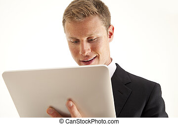 Businessman using computer - Head and shoulder portrait of...