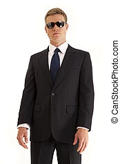 Businessman in suit and sunglasses