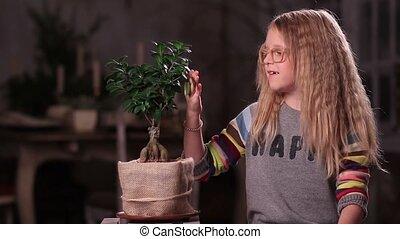 Little girl taking care of green plant - Lovely nature...