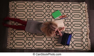 Little girl studying and working on laptop - Top view of...