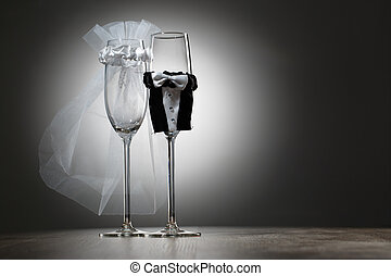 Two empty decorated champagne glasses for wedding party on...