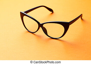 Brown glasses on orange background - Brown glasses with...