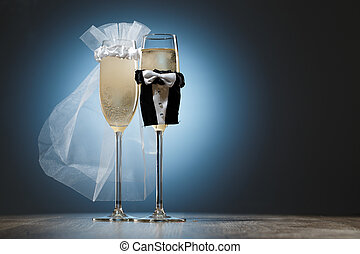 Two cooled glasses of champagne decorated for married couple...