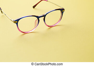 Multi-colored glasses on empty space - Multi-colored glasses...