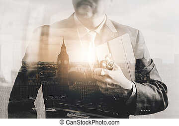 Double exposure of smart medical doctor working with London...