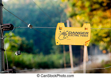 Danger electric fence board in jungle - Danger electric...