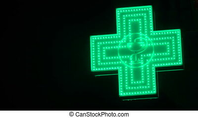 Iluminated Green Pharmaceutical Cross. Pharmacy Street Sign.