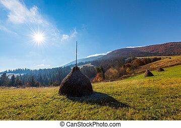 haystack - Amazing rural scene on autumn valley. Haystack on...