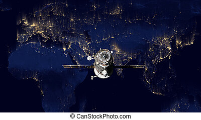 Spacecraft Progress orbiting the earth. Elements of this...