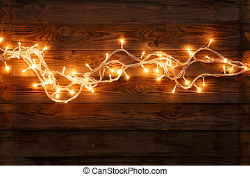 Festoon on brown wooden background - Christmas yellow...
