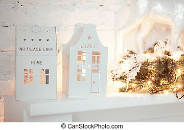 Christmas candle houses. Burning lantern and xmas decoration...
