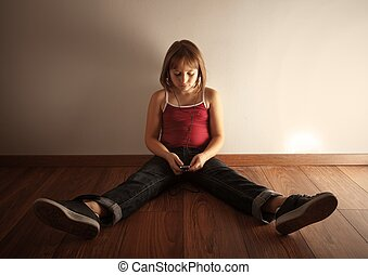 Girl listening music - Little girl sitting on the floor in...